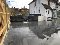 Extensive patio and walled water feature
